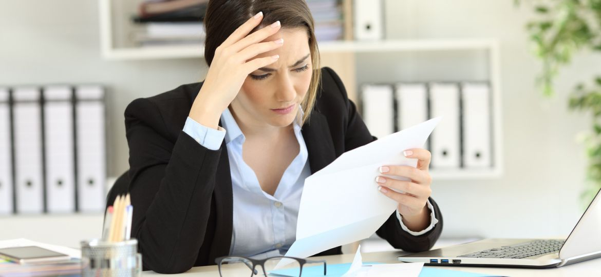 Worried executive reading a letter at office