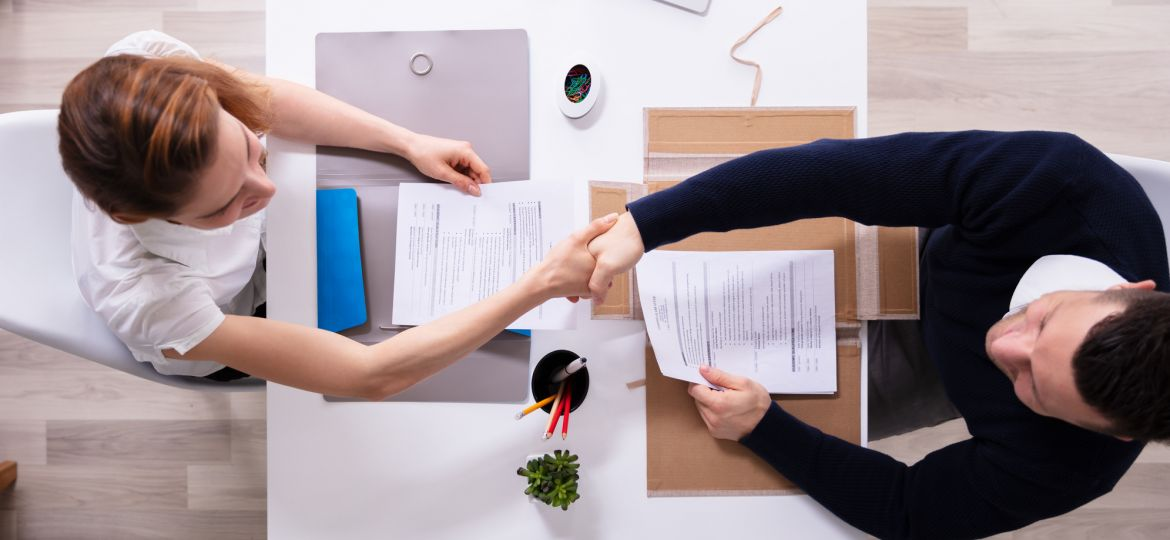 Businessman Shaking Hand With Female Applicant
