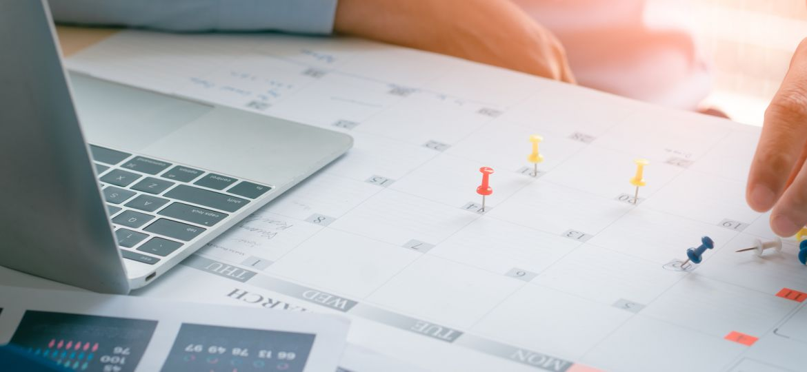 Business Man with laptop, Calendar in office, Business management event . Organizational management, business plan targeted marketing activities, media relations advertising.